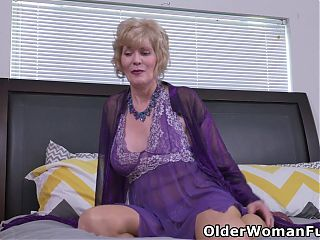 Busty grandmother Sindee Dix works her old pussy