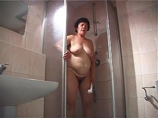 Chubby granny takes a shower