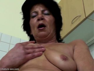 Taboo sex granny gets hard fisting on kitchen