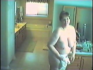 Mature milf with saggy tits strips