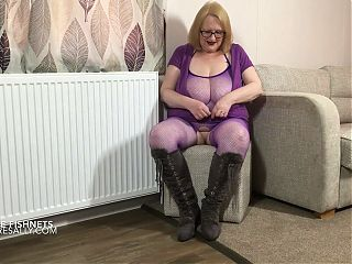 Sally in her purple fishnet bodystockings