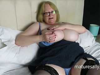 Granny loves to show off her huge tits and pussy