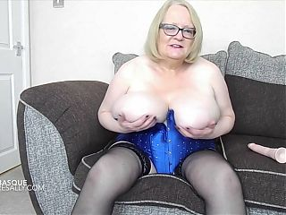 Sally playing with dildo in her blue basque