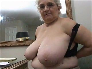 A Very Sexy Grenny Getting Off in Her Office